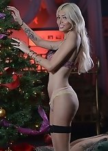 Hot Jenna spreads by the xmas tree