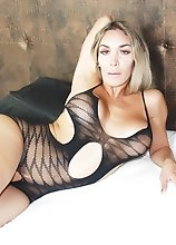 BIG BOOTY BLONDE in fishnet bodysuit